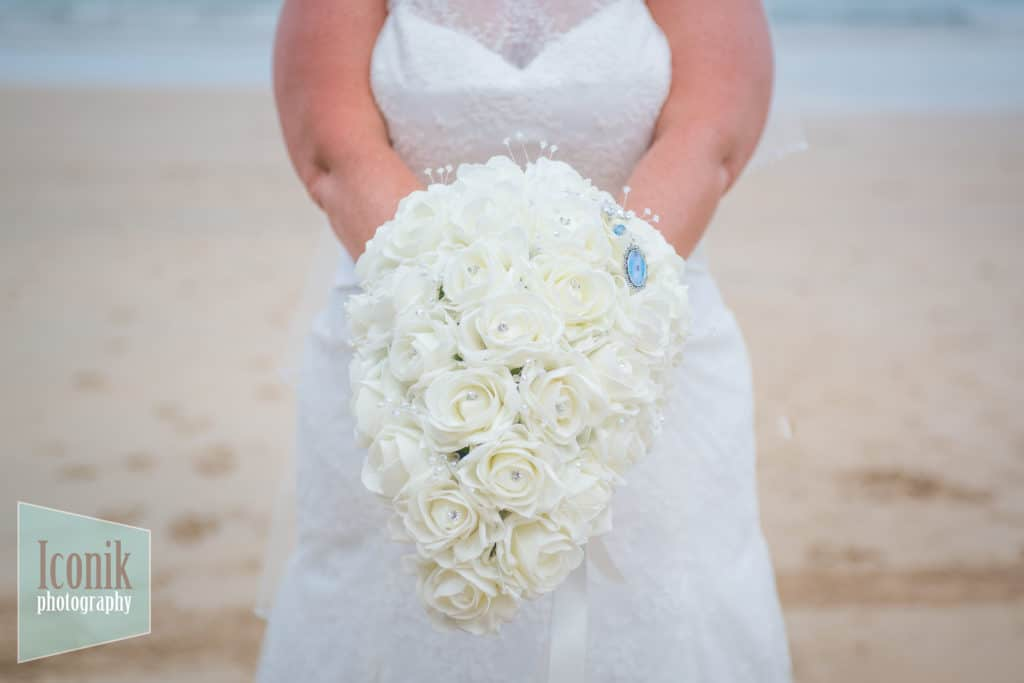 Wedding Photographers in Cornwall - Bride bouquet on St Ives Porthminster Beach