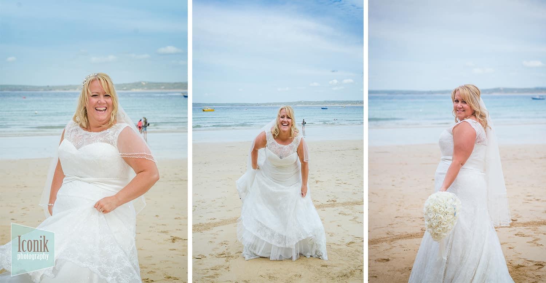 Wedding Photographer in Cornwall - Bride on St Ives Porthminster Beach