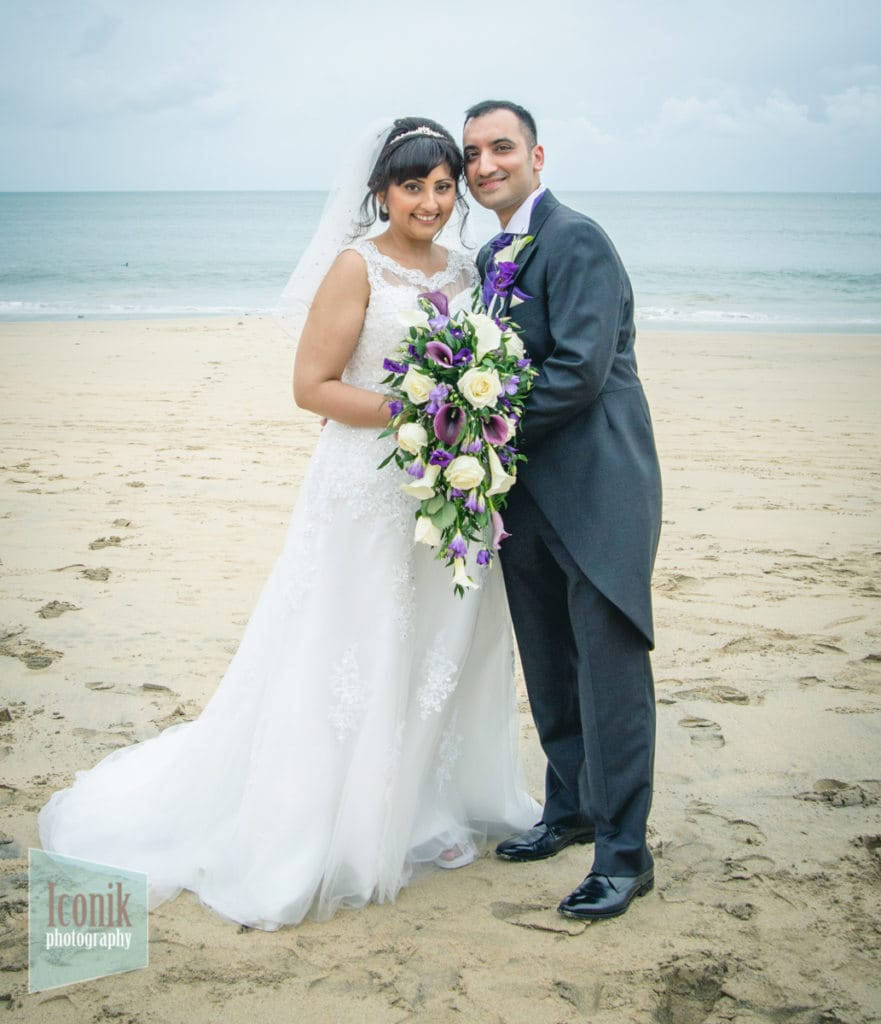 bride and groom at Carbis Bay beach - Asian Wedding Photography Cornwall